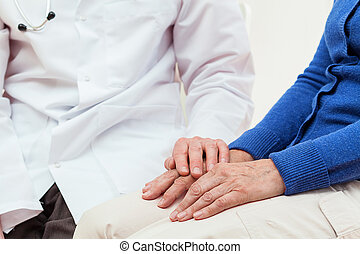 Doctor's help for an elderly woman, isolated background