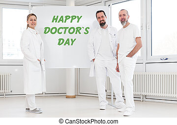 doctors in front of a whiteboard with the text happy doctor's day