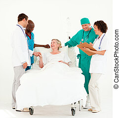 Doctors looking after a patient and bedside - Team Doctors ...