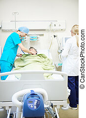Doctors looking after recovering patient
