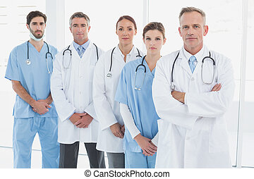 Doctors looking at the camera