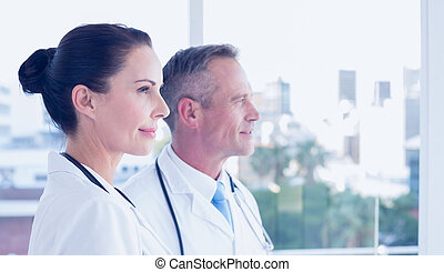 Doctors looking out the window