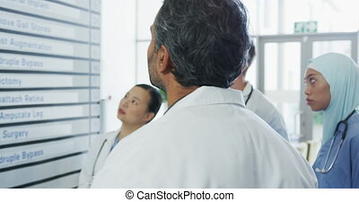 Doctors meeting around a whiteboard 4k - Arc shot head and ...