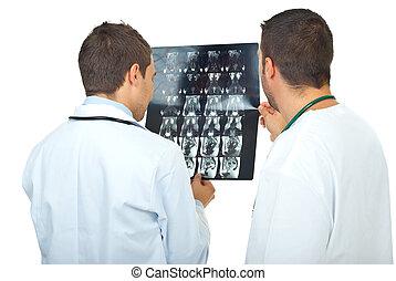 Doctors men review magnetic resonance - Two doctors men...