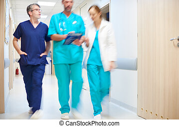 Doctors moving in blurred motion