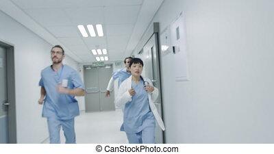 Doctors running through a hospital corridor 4k