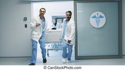 Doctors running with patient in hospital bed in emergency 4k...