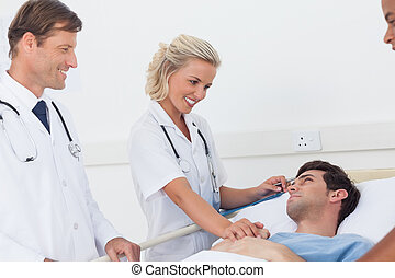 Doctors speaking to a patient