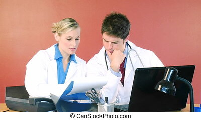 Doctors studying a patient report