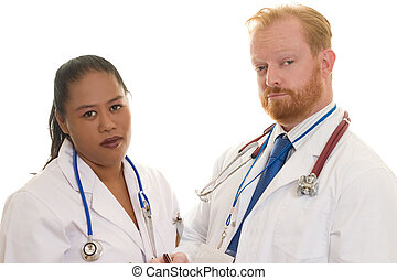 Doctors - Two doctors - man and woman - diverse. Focus on...