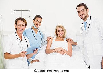 Doctors visiting patient