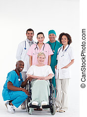Doctors with a patient in a wheel chair