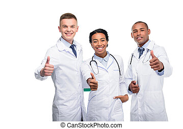 doctors with thumbs up - multiethnic female and male doctors...