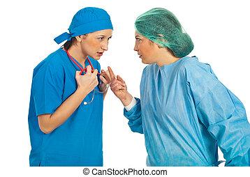 Doctors women conflict - Two nervous doctors women having...