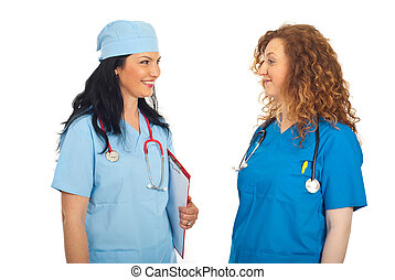 Doctors women having happy conversation