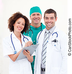 Doctors working in a Hospital ward - Team of Doctors working...