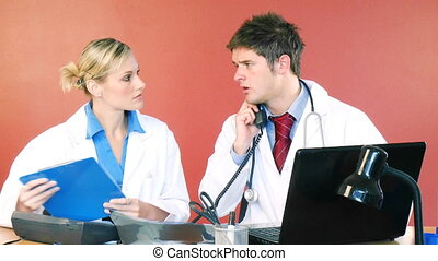 Doctors working in office and talking on phone