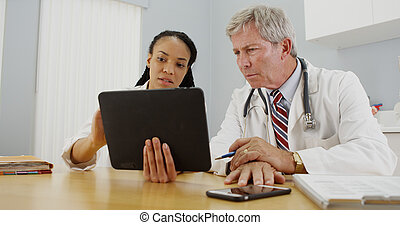 Doctors working together in the office