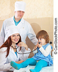 Doctors working with baby