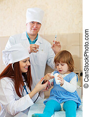Doctors working with baby girl