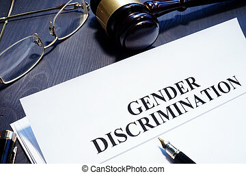 Document about Gender Discrimination and gavel on a desk.