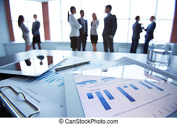 Document on touchpad - Close-up of business document in...