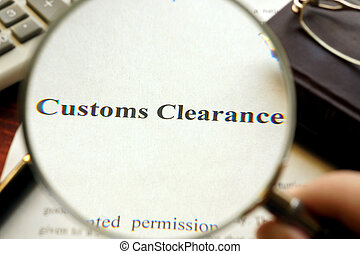 Document with title Customs Clearance on a table. Selective...