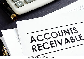Documents about Accounts receivable, pen and calculator.