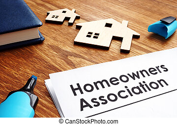 Documents about Homeowners Association HOA on a desk.