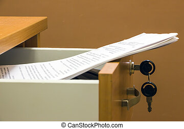 Documents in a desk drawer