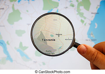 Dodoma, Tanzania. Political map. City visualization illustrative concept on display screen through magnifying glass in the hand.