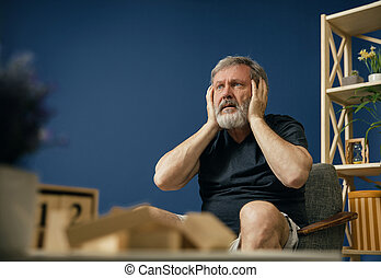 Old bearded man with alzheimer desease - Doesn't hear his...