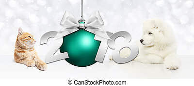 Dog and cat with christmas blue ball and 2018 text on white...