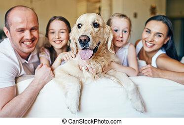 Dog and happy family