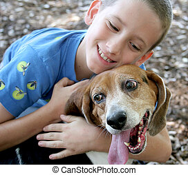 Dog and Her Boy - A beagle enjoying a hug from an adorable...