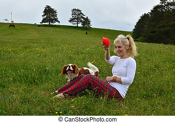 Dog and Lady Playing in a Meadow