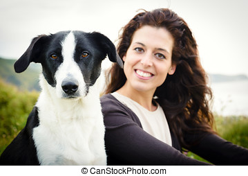 Dog and woman portrait. Beautiful happy woman with her pet on summer travel vacation to coast.