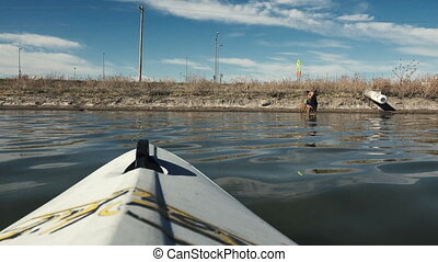 Dog Coming At Kayak POV Waterlevel - A dog with a life...