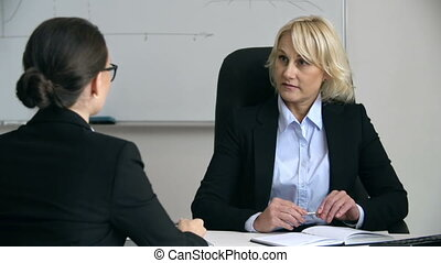 Dog Day - Bossy woman talking to subordinate employee seated...