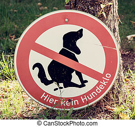 Dog excrement to ban - No dog poop zone sign.