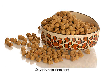 bowl of dog kibble in a heart shaped dog dish isolated on white background