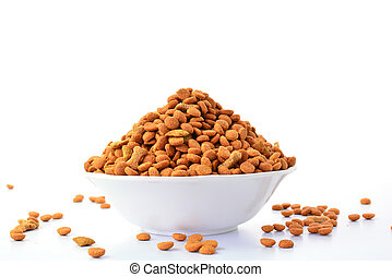 dog food treats in bowl isolated on white background