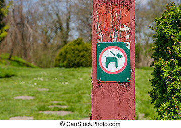 Dog in leash sign