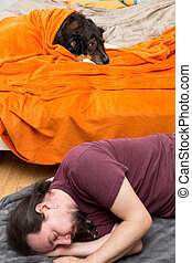 Dog in the Bed, Man sleeping on the ground