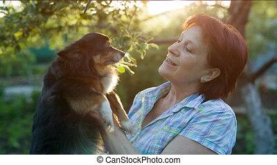 dog licks the mistress