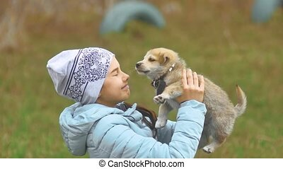 dog puppy pet and baby girl teen close up portrait of happy girl on in the forest smiling cheerful outdoors dressed jacket