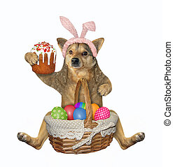 Dog sits with easter cake and eggs 2