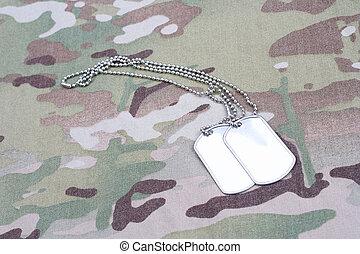 dog tag on multicam camouflage uniform