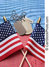 Dog Tags and Flags on Patriotic Table - Overhead shot of a...
