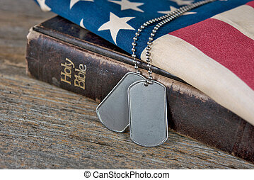 dog tags on Bible and flag